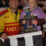 """Liquid"" Lou Cicconi and young ""Super Fan"" showing off hardware in victory lane @ Ace Speedway. - Robert Gill Photo"