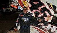 Johnny Herrera kept his Lucas Oil ASCS presented by K&N Filters National title hopes alive by racing to victory lane in Friday night's 25-lap preliminary feature atop the 5/16-mile Southern New Mexico Speedway clay oval.