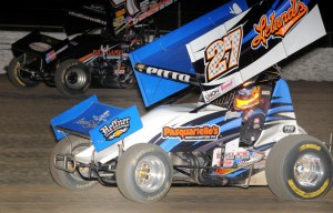 Craig Dollansky (#7) racing with Daryn Pittman (#27) for the lead at Volusia Speedway Park. - Lonnie Wheatley Photo