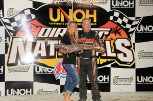 Sammy Swindell receives a unique trophy for winning the overall UNOH Dirtcart Nationals title at Volusia Speedway Park. - Lonnie Wheatley Photo
