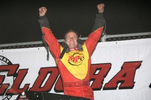 Tracy HInes enthusiastically exits his car in victory lane at Eldora Speedway after winning the Jud Larson / Don Branson Clasic to kick off Border Wars with the USAC National Sprint Car Series. - Jan Dunlap Photo