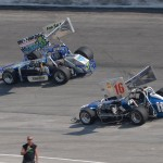 #16 Paul White and #5 Sondi Eden battle during the 30 lap supermodified feature event. - Bill Miller Photo