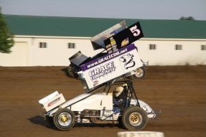 Brian Smith (2+) racing with Byron Reed (#5R) Friday at Attica Raceway Park. - Action Photos