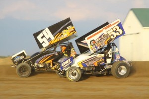 #53 Phil Gressman goes wheel to wheel with #54 Cap Henry during Ohio Sprint Speedweek at Attica Raceway Park. - Action Photo