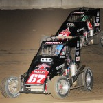 Kyle Larson (71) and Rico Abreu (67) battle for the lead in Sunday night's POWRi main event at U.S. 36 Raceway. - TWC Photo
