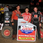 Kyle Larson is joined on the podium by runner-up Brad Kuhn (right) and third-place finisher Zach Daum (left).  - TWC Photo