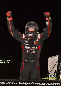 Jason Meyers celebrates winning the Thursday night feature at the Knoxville Nationals. - Mike Campbell/campbellphoto.com