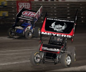 Donny Schatz (15) and Jason Meyers (21m) battle for 2nd during the National Speed Sport News World Challenge at Knoxville Raceway in Knoxville, Iowa on August 10, 2012.  Schatz would win while Meyer would finish 3rd to Sammy Swindell.  - Mermaid Racing Photos / Serena Dalhamer