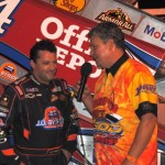 Tony Stewart with ASCS SOD announcer Mike Strevel in victory lane at Plymouth Speedway. - T.J. Buffenbarer Photo