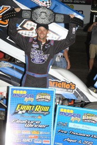 Daryn Pittman lifts the belt after winning the Front Row Challenge at Southern Iowa Speedway on Monday. - Action Photo