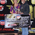 Keith Kunz accepting on behalf of Kyle Larson in victory lane at the 4-Crown Nationals.   - Bill Miller Photo
