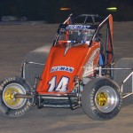 Coleman Gulick with steam coming off the right rear tire while leading the sprint car feature event. - Bill Miller Photo
