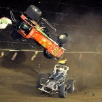 Kyle Larson (#69) just after being pounded by Mitch Wissmiller (#1) during the sprint car feature at the 4-Crown Nationals. - Jan Dunlap Photo