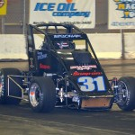 "Derek Bischak won the 50 lap ""Rumble Series"" midget feature event on Saturday night December 29, 2012 at the Memorial Coliseum Expo Center in Fort Wayne, Indiana. - Bill Miller Photo"