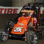 Shane Cottle (05C) throttles past Ryan Bernal (73) during practice sessions at the 2013 Chili Bowl Midget Nationals in Tulsa, Oklahoma on January 7, 2013.  (Serena Dalhamer photo)