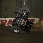 Trey Starks hits the hay bales during practice sessions at the 2013 Chili Bowl Midget Nationals in Tulsa, Oklahoma on January 7, 2013.  (Serena Dalhamer photo)