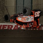 Cody Ledger takes a tumble during practice sessions for the 2013 Chili Bowl Midget Nationals in Tulsa, Oklahoma on January 7, 2013.  (Serena Dalhamer photo)