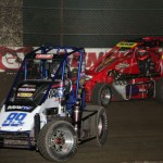 Josh Lakatos (89K) battles Andy Malpocker (22A) during heat race