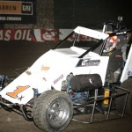 Bryan Debrick jumps the berm and takes a shortcut during the 2013 Chili Bowl Midget Nationals.  (Serena Dalhamer photo)