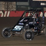 Brady Bacon briefly took the lead, but ultimately took 2nd during Night #1 of the 2013 Chili Bowl Midget Nationals.  (Serena Dalhamer photo)