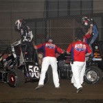 Levi Jones (56A) and Jon Stanbrough (4) stop in turn 2 to discus