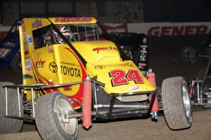 Tracy Hines jumps the berm during the 1st B feature of the 2013