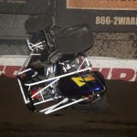 D. J. Netto tumbles during the 2nd B feature at Chili Bowl Midge