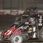 Kyle Larson (71) tries the high side against Jason Meyers (71K)