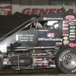 Kevin Swindell celebrates in his car after taking the checkers f