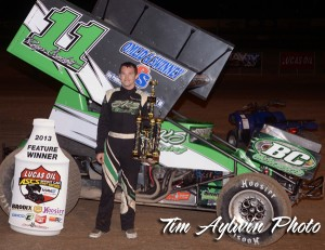Oregon's Roger Crockett stands in victory lane at the Tucson International Raceway. The win marks Crockett's third with the Lucas Oil ASCS presented by MAVTV. (ASCS / Aylwin Photo)