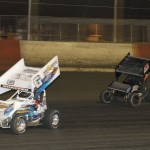 Tim Shaffer (#6) passes Micheal Miller (#4) for the lead at East Bay Raceway Park during the opening night of the 2013 Winter Nationals. - Chad Ruhl Photo