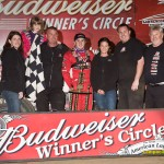 Kevin Thomas and crew celebrate winning the USAC Sprint feature at Lawrenceburg Speedway. - Mike Campbell Photo
