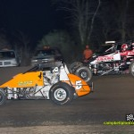 Robert Ballou (#5) racing with Kevin Thomas, Jr. (#17) for the lead at Gas City I-69 Speedway. - Mike Campbell Photo
