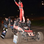 Kevin Thomas, Jr. in victory lane at Gas City I-69 Speedway. Kevin Thomas Jr. (#17 outside) and Thomas Meseraull (#17 inside) battle for the lead. . - Bill Miller Photo