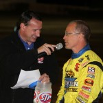 Joey Saldana speaking with John Gilbson Saturday at Tri-State Speedway. - James McDonald / Apexonephoto