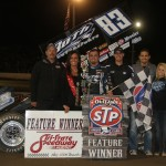 Tim Kaeding with his crew in victory lane after winning Saturday night's World of Outlaws feature at Tri-State Speedway. - James McDonald / Apexonephoto
