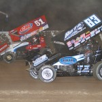Tim Kaeding (#83) racing with Paul McMahan (#51) at Tri-State Speedway. - James McDonald / Apexonephoto.com