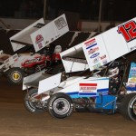 Levi Jones (#12) racing with Wes McIntyre (#83) at Tri-State Speedway. - James McDonald / Apexonephoto