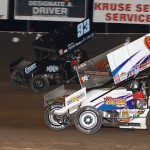 Chad Kemenah (#63) racing with Sheldon Haudenschild (#93) Saturday night at Tri-State Speedway. - James McDonald / Apexonephoto.com