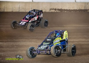 Chase Stockton (32) and Kevin Thomas battle for the lead at Lawrenceburg Speedway. - Mike Campbell Photo