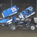 #4 Jamie Miller races against #25 Jason Keckler during 305 sprint racing action. - Action Photo