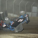 Andrew Palker gets upside down during the 410 sprint racing action. - Action Photo