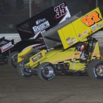 #97 Phil Gressman and #35 Stuart Brubaker battle during the 410 sprint action. - Action Photo