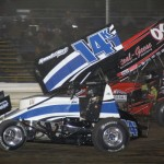 #14k Dale Blaney duels with #09 Craig Mintz for second place during the 410 sprint feature at Attica Raceway Park. - Action Photo