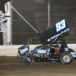 Sheldon Haudenschild takes the checkered flag for his first 410 sprint feature win at Attica Raceway Park. - Action Photo