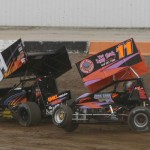 Shawn Hubler gets upside down during the 410 sprint hot laps. - Action Photo