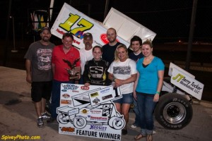 Harli White in victory lane at the Salina Highbanks Speedway Mike Spivey Photo