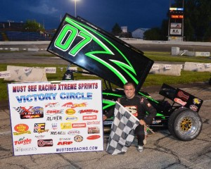 Jacob Wilson is all smiles after winning the 60 lap Must See Racing Xtreme Sprint Series event at the Anderson Speedway on Wednesday night May 22, 2013. - Bill Miller Photo