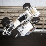 Don Droud, Jr. fails to avoid the broken sprinter of Robert Bell and takes a tumble during World of Outlaws heat race action at Knoxville Raceway on 11 May 2013.  - Serena Dalhamer photo