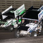 Austin McCarl (17A), Josh Schneiderman (49), Kyle Larson (1K), and Geoff Dodge (7m) fight for track space during the World of Outlaws last chance race at Knoxville Raceway on 11 May 2013. - Serena Dalhamer photo